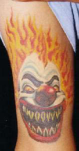 Smiling clown tattoo
