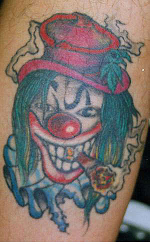 Bad clown with cigar tattoo