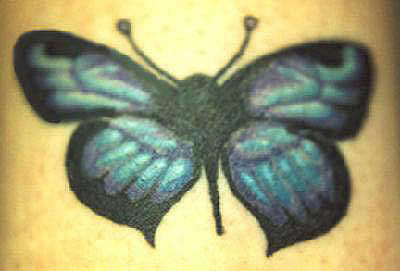 Turquoise-colored butterfly tattoo