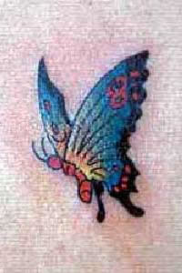 Small blue butterfly tattoo